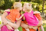 Mom and Dad Holding Kissing Brother and Sister Toddlers in the Park.