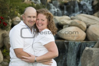 Attractive Couple Pose for Portrait in the Park.