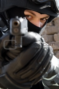 Portrait of soldier targeting with pistol