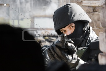 Portrait of soldier targeting with a pistol