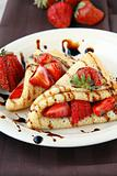 sweet thin french style crepes, served with strawberries,chocolate sauce