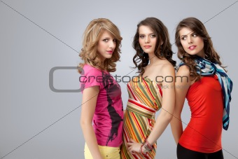 colorful studio portrait three beautiful young women