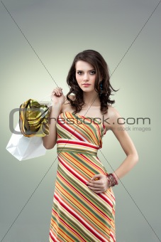 colorful studio portrait beautiful young woman holding shopping