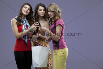 young women smiling high heels shopping