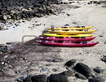 Five Kayaks On The Beach