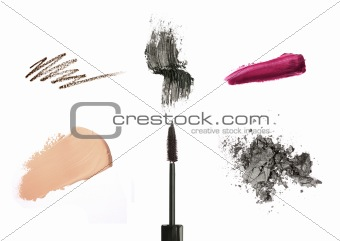 Cosmetic products isolated on white: mascara, lip gloss or lipstick, concealer, eyeliner