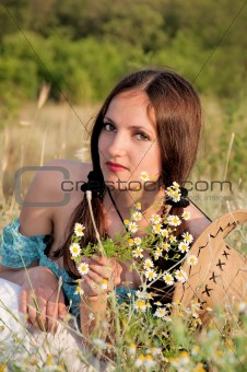 beautiful woman in a field of flowers chamomile
