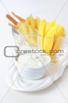 Fresh mango and pineapple and curd cheese