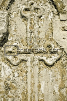 Cross on the old wall (bas-relief)