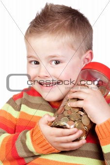 Adorable child with a glass jar with many coins