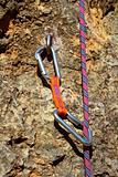 climbing shackles and rope on a rock wal