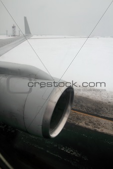 airplane wing aircraft turbine landing in snow winter