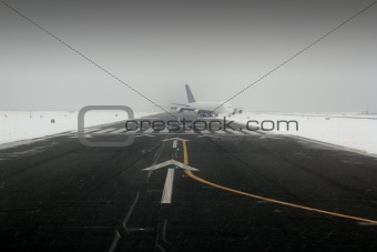 airplane wing aircraft landing in snow winter runway
