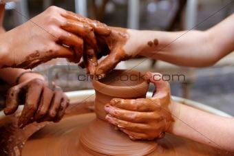 clay potter hands wheel pottery work workshop teacher
