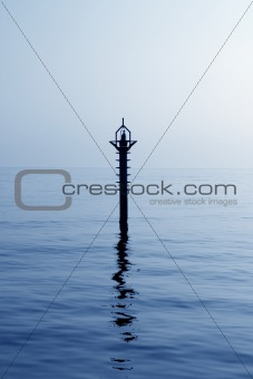 backlight beacon in Mediterranean blue sea reflection