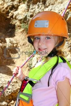 climbing little girl smiling portrait helmet rope