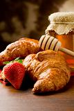 Croissants with honey and strawberries