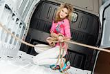 Sexy young woman in cargo van inside