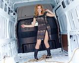 Pretty young woman in cargo van inside