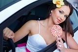Young woman with candy with New car