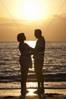 Senior Man &amp; Woman Couple on Beach at Sunset