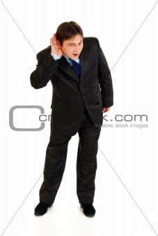 Full length portrait of stressful businessman holding hand at ear and listening