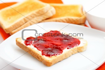 Toast bread with jam on a plate