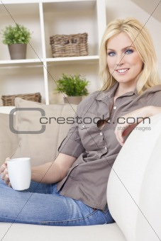 Beautiful Blond Woman Drinking Tea or Coffee At Home