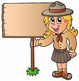 Scout girl holding wooden board