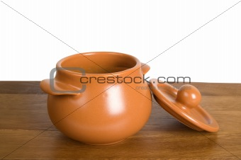 Ceramic pot on the wooden board