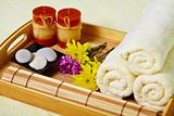 Tray of towels, candles and pebbles - spa