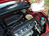 Adding Motor Oil to Car