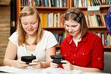 Teens Texting in Library