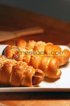 fresh baked pastry with sausage and sesame