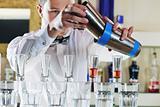 pro barman prepares coctail drink