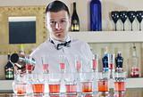 pro barman prepares coctail
