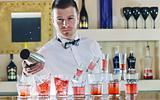 pro barman prepares cocktail