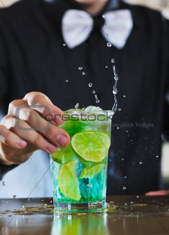 pro barman prepares cocktail drink