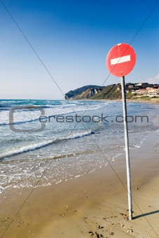 One way sign on the beach