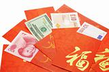 Multi national currency notes in Chinese red packets