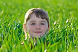 Little girl on the green grass
