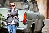 Boy near retro car