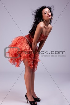 beautiful woman with elegant dress, hair on wind, studio shot