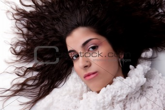 beautiful girl lying looking up, isolated on white background. Studio shot.