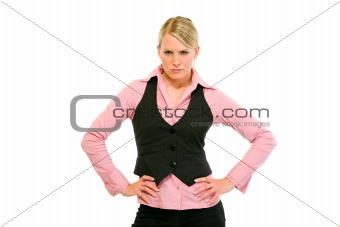 Authoritative modern business woman with hands on hips
