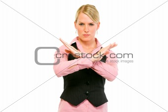 Authoritative modern business woman with crossed arms. Forbidden gesture