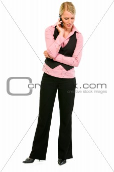Full length portrait of smiling business woman talking on mobile phone