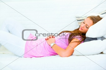 Attractive woman sleeping on couch at livingroom