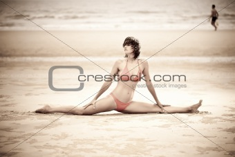 Beautiful woman doing stretches exercise