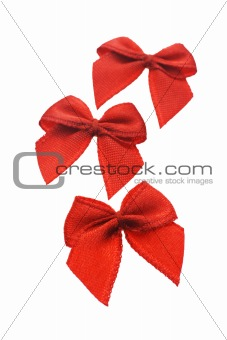 Three mini red bows